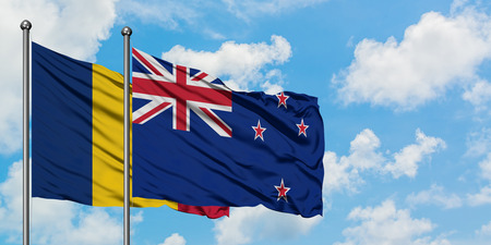 Chad and New Zealand flag waving in the wind against white cloudy blue sky together. Diplomacy concept, international relations. Archivio Fotografico