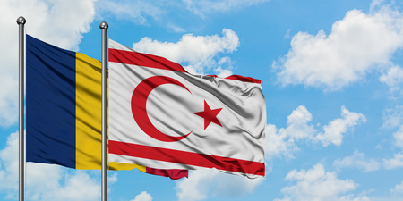 Chad and Northern Cyprus flag waving in the wind against white cloudy blue sky together. Diplomacy concept, international relations.