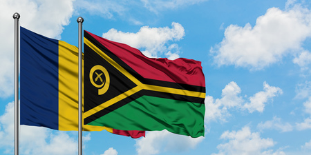 Chad and Vanuatu flag waving in the wind against white cloudy blue sky together. Diplomacy concept, international relations.
