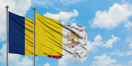 Chad and Vatican City flag waving in the wind against white cloudy blue sky together. Diplomacy concept, international relations.