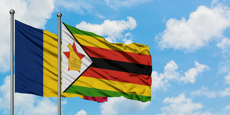 Chad and Zimbabwe flag waving in the wind against white cloudy blue sky together. Diplomacy concept, international relations.