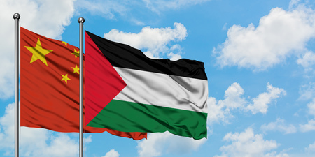 China and Palestine flag waving in the wind against white cloudy blue sky together. Diplomacy concept, international relations.
