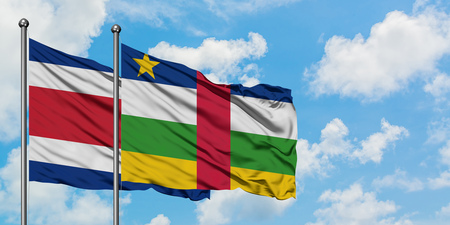 Costa Rica and Central African Republic flag waving in the wind against white cloudy blue sky together. Diplomacy concept, international relations.