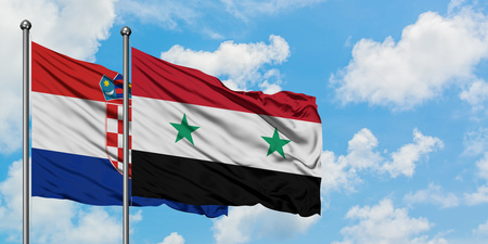 Croatia and Syria flag waving in the wind against white cloudy blue sky together. Diplomacy concept, international relations. Stockfoto