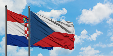 Croatia and Czech Republic flag waving in the wind against white cloudy blue sky together. Diplomacy concept, international relations.
