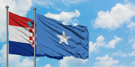 Croatia and Somalia flag waving in the wind against white cloudy blue sky together. Diplomacy concept, international relations.