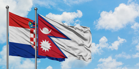 Croatia and Nepal flag waving in the wind against white cloudy blue sky together. Diplomacy concept, international relations.