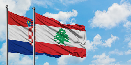 Croatia and Lebanon flag waving in the wind against white cloudy blue sky together. Diplomacy concept, international relations.