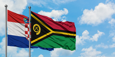 Croatia and Vanuatu flag waving in the wind against white cloudy blue sky together. Diplomacy concept, international relations.