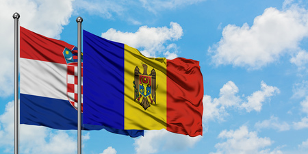 Croatia and Moldova flag waving in the wind against white cloudy blue sky together. Diplomacy concept, international relations.