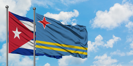 Cuba and Aruba flag waving in the wind against white cloudy blue sky together. Diplomacy concept, international relations.