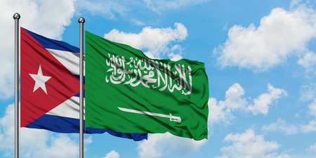Cuba and Saudi Arabia flag waving in the wind against white cloudy blue sky together. Diplomacy concept, international relations.