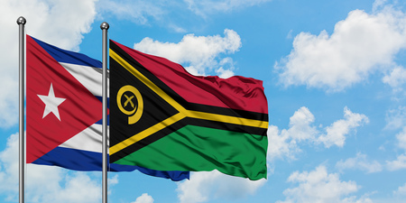 Cuba and Vanuatu flag waving in the wind against white cloudy blue sky together. Diplomacy concept, international relations. Stock fotó