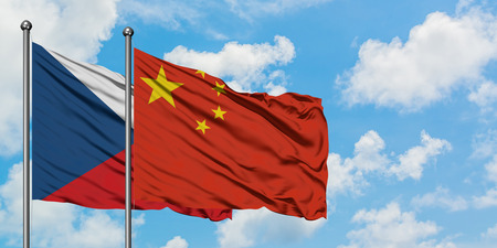 Czech Republic and China flag waving in the wind against white cloudy blue sky together. Diplomacy concept, international relations. Stock Photo