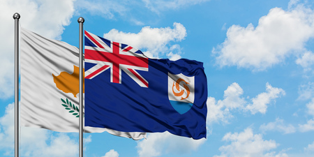 Cyprus and Anguilla flag waving in the wind against white cloudy blue sky together. Diplomacy concept, international relations. Standard-Bild