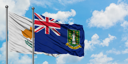 Cyprus and British Virgin Islands flag waving in the wind against white cloudy blue sky together. Diplomacy concept, international relations.