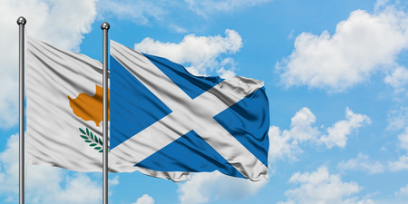 Cyprus and Scotland flag waving in the wind against white cloudy blue sky together. Diplomacy concept, international relations.