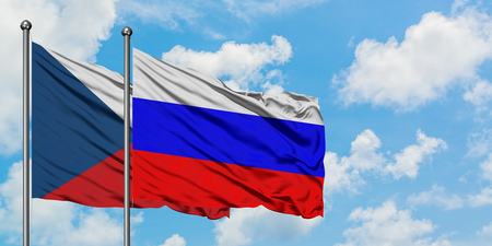 Czech Republic and Russia flag waving in the wind against white cloudy blue sky together. Diplomacy concept, international relations.