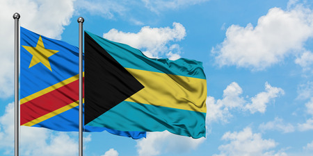 Congo and Bahamas flag waving in the wind against white cloudy blue sky together. Diplomacy concept, international relations. Stock Photo - 123298223