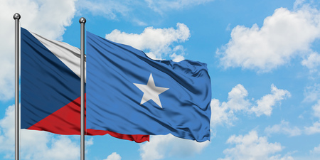 Czech Republic and Somalia flag waving in the wind against white cloudy blue sky together. Diplomacy concept, international relations.