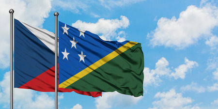 Czech Republic and Solomon Islands flag waving in the wind against white cloudy blue sky together. Diplomacy concept, international relations. Stok Fotoğraf