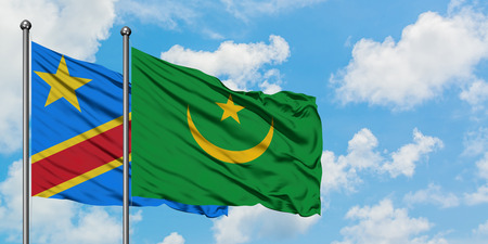 Congo and Mauritania flag waving in the wind against white cloudy blue sky together. Diplomacy concept, international relations.