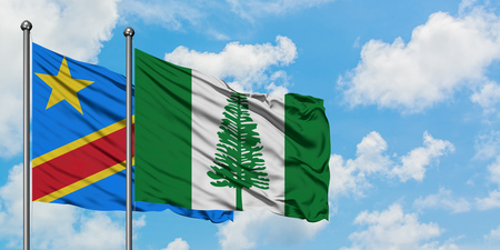 Congo and Norfolk Island flag waving in the wind against white cloudy blue sky together. Diplomacy concept, international relations.