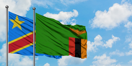 Congo and Zambia flag waving in the wind against white cloudy blue sky together. Diplomacy concept, international relations.