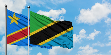 Congo and Tanzania flag waving in the wind against white cloudy blue sky together. Diplomacy concept, international relations. Stock fotó
