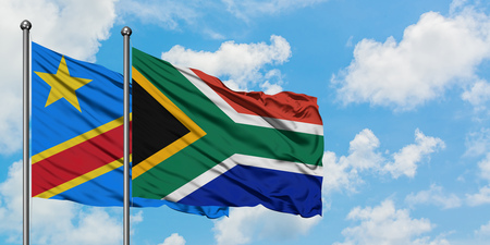 Congo and South Africa flag waving in the wind against white cloudy blue sky together. Diplomacy concept, international relations. 스톡 콘텐츠