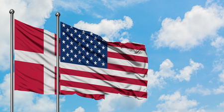 Denmark and United States flag waving in the wind against white cloudy blue sky together. Diplomacy concept, international relations. Фото со стока - 123322903
