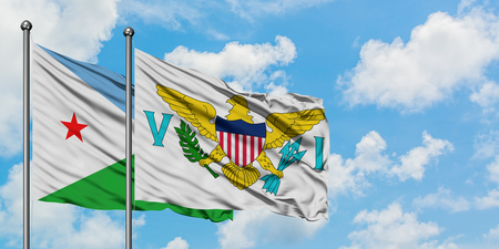 Djibouti and United States Virgin Islands flag waving in the wind against white cloudy blue sky together. Diplomacy concept, international relations.