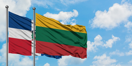 Dominican Republic and Lithuania flag waving in the wind against white cloudy blue sky together. Diplomacy concept, international relations. 写真素材