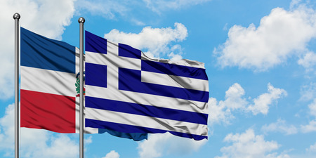 Dominican Republic and Greece flag waving in the wind against white cloudy blue sky together. Diplomacy concept, international relations. Standard-Bild