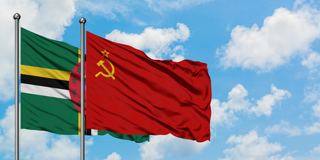 Dominica and Soviet Union flag waving in the wind against white cloudy blue sky together. Diplomacy concept, international relations.