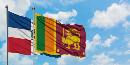 Dominican Republic and Sri Lanka flag waving in the wind against white cloudy blue sky together. Diplomacy concept, international relations.