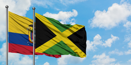 Ecuador and Jamaica flag waving in the wind against white cloudy blue sky together. Diplomacy concept, international relations. Stock Photo