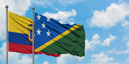 Ecuador and Solomon Islands flag waving in the wind against white cloudy blue sky together. Diplomacy concept, international relations.