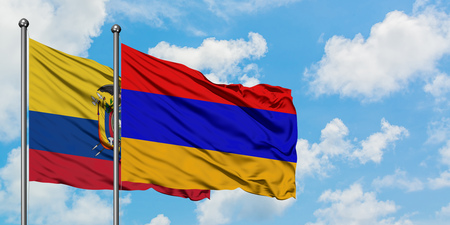 Ecuador and Armenia flag waving in the wind against white cloudy blue sky together. Diplomacy concept, international relations.