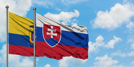 Ecuador and Slovakia flag waving in the wind against white cloudy blue sky together. Diplomacy concept, international relations.