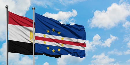 Egypt and Cape Verde flag waving in the wind against white cloudy blue sky together. Diplomacy concept, international relations.