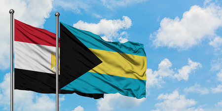 Egypt and Bahamas flag waving in the wind against white cloudy blue sky together. Diplomacy concept, international relations. Stock Photo - 123368548