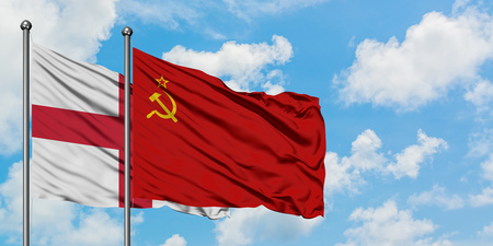 England and Soviet Union flag waving in the wind against white cloudy blue sky together. Diplomacy concept, international relations.