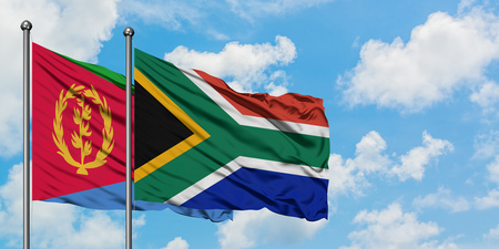 Eritrea and South Africa flag waving in the wind against white cloudy blue sky together. Diplomacy concept, international relations.