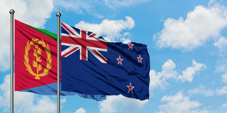 Eritrea and New Zealand flag waving in the wind against white cloudy blue sky together. Diplomacy concept, international relations.