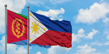 Eritrea and Philippines flag waving in the wind against white cloudy blue sky together. Diplomacy concept, international relations.