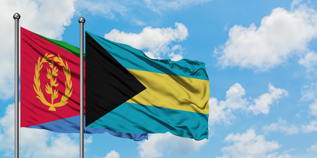 Eritrea and Bahamas flag waving in the wind against white cloudy blue sky together. Diplomacy concept, international relations. Stock Photo - 123396074