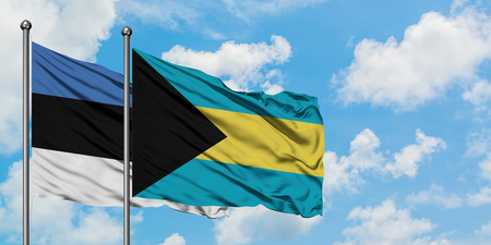 Estonia and Bahamas flag waving in the wind against white cloudy blue sky together. Diplomacy concept, international relations. Stock Photo - 123396488