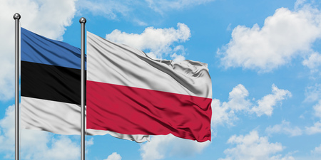 Estonia and Poland flag waving in the wind against white cloudy blue sky together. Diplomacy concept, international relations.