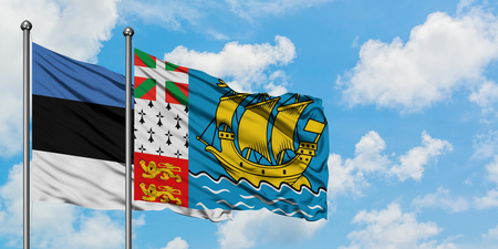 Estonia and Saint Pierre And Miquelon flag waving in the wind against white cloudy blue sky together. Diplomacy concept, international relations. Banco de Imagens